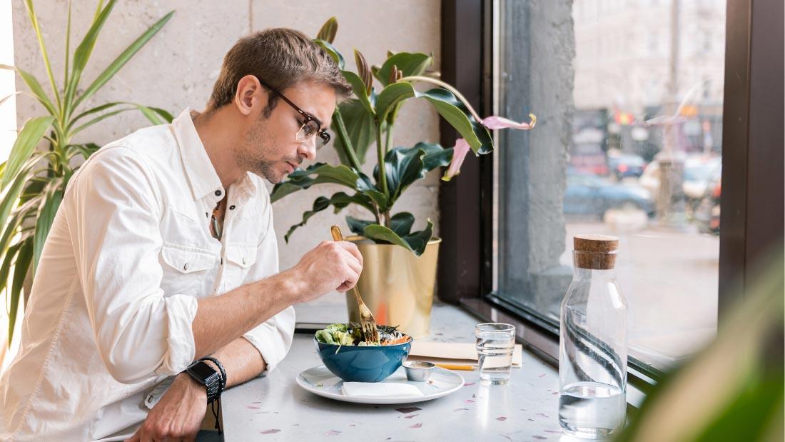 Man having vegan lunch