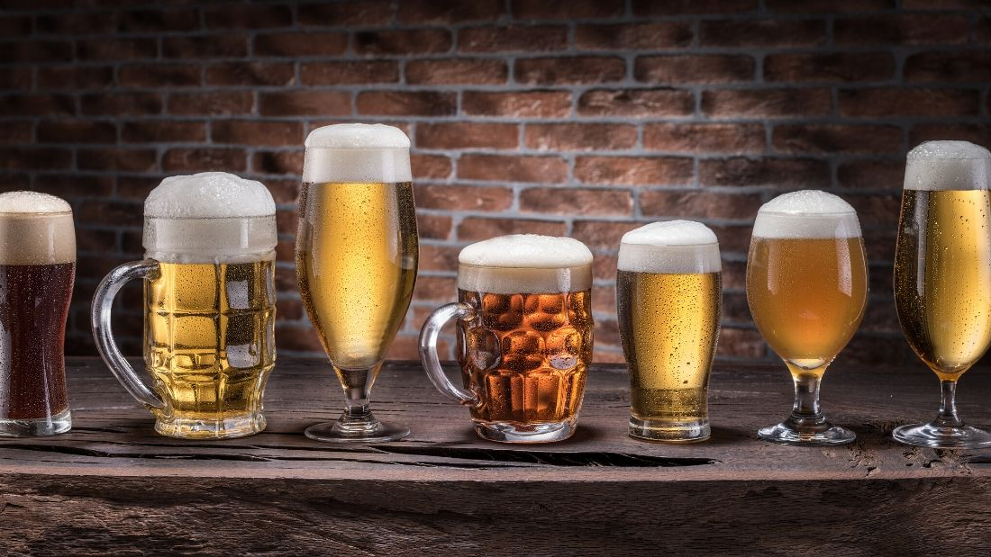 pints of beer lined up on a bar