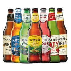 an array of thatchers vegan cider bottles in a row