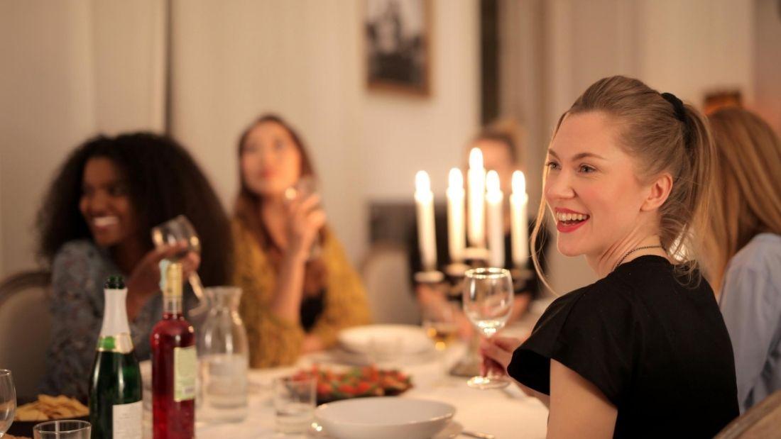 vegan community - friends eating round table