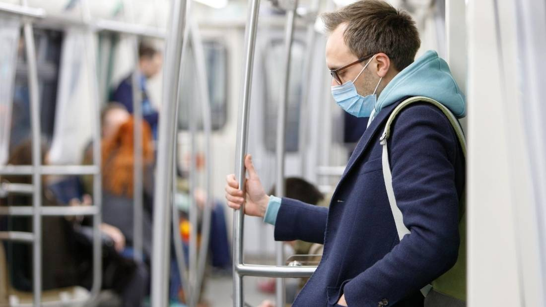 public health man on train in mask