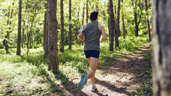 runner in woods