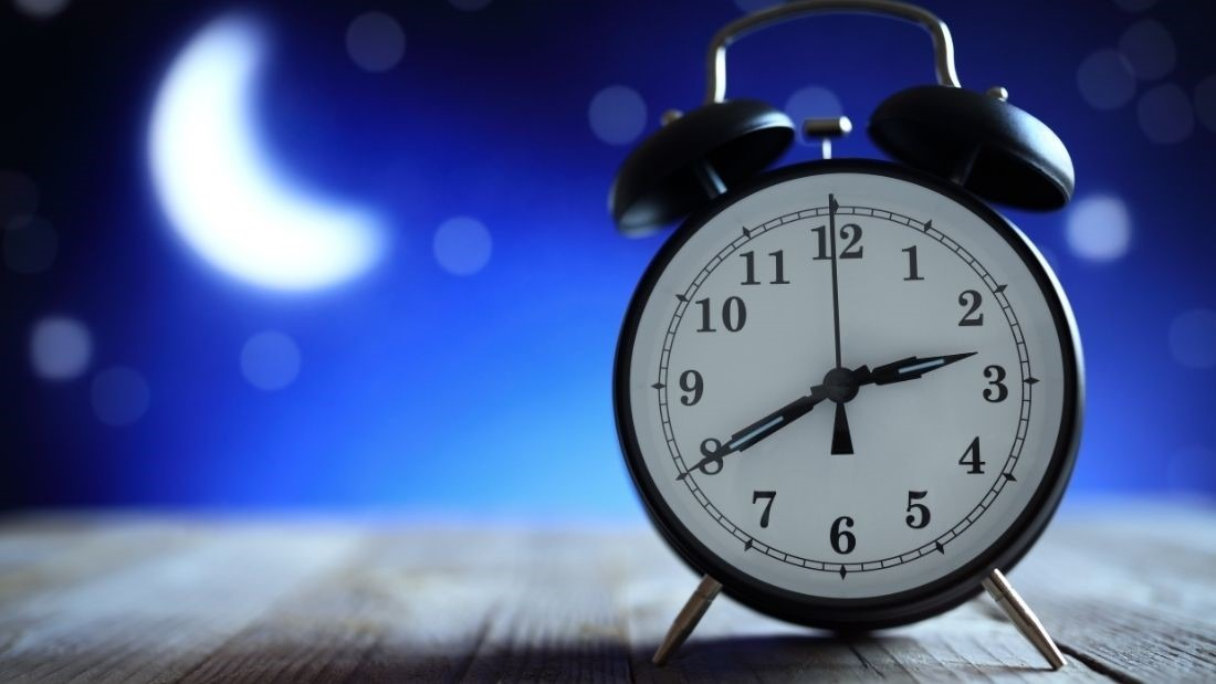 Alarm clock on night background