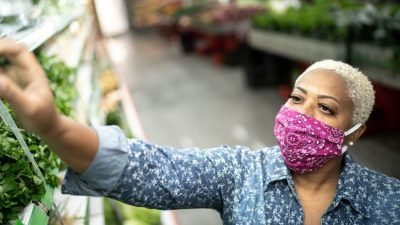Buying veg in a face mask