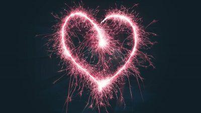 Neon pink heart on black background