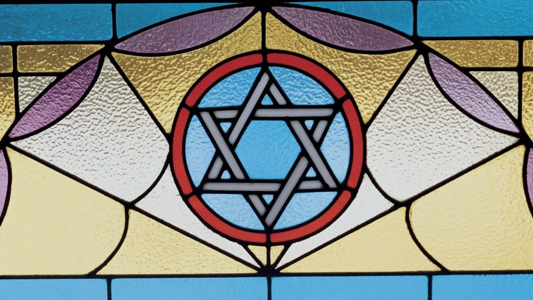 stain glass window with the star of david on it
