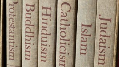 row of books with different religions written on them