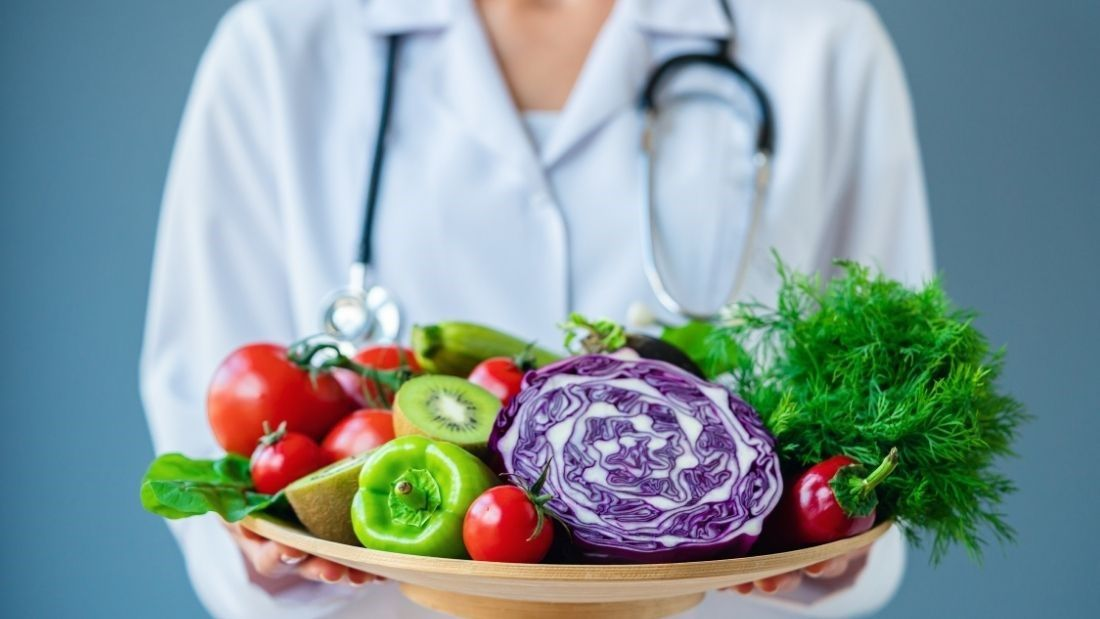 Doctor with fruit and veg