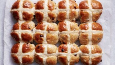 Vegan hot cross buns on white background