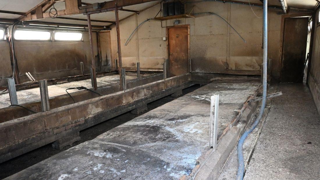 An empty farrowing shed