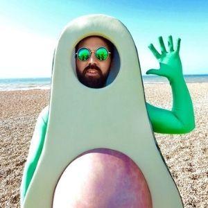 man dressed in avocado fancy dress