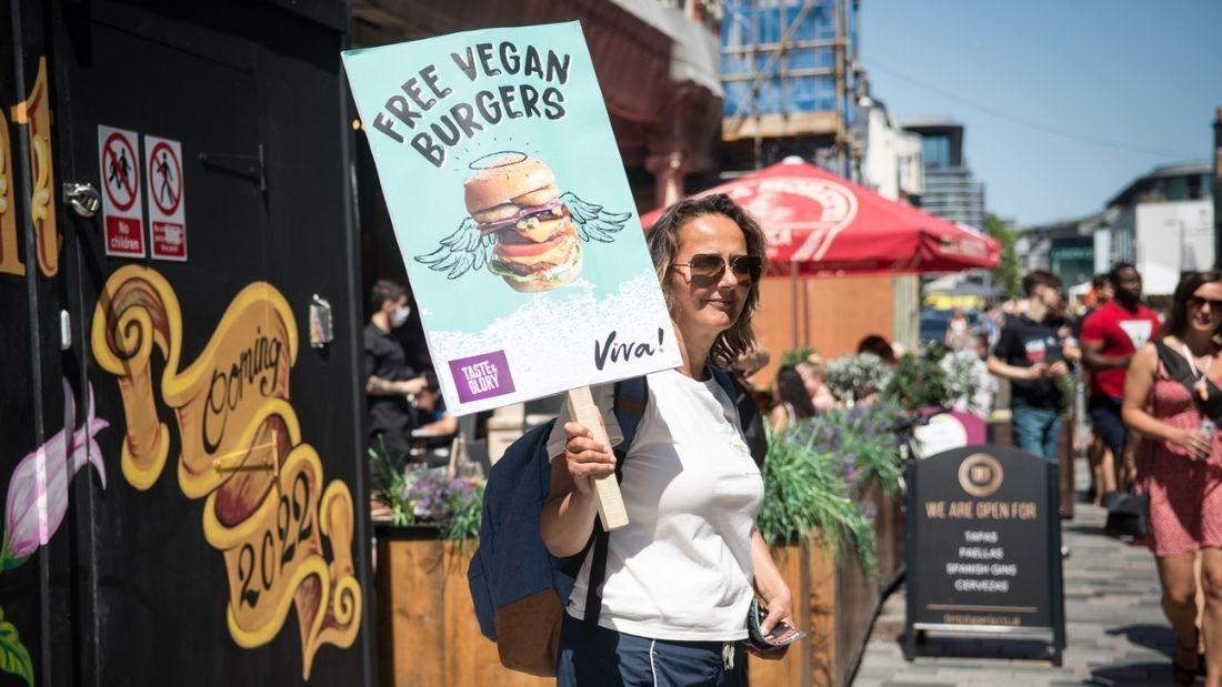 Volunteer holding burger sign