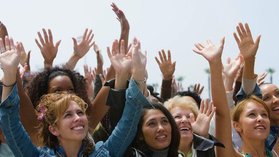 women wit hands up