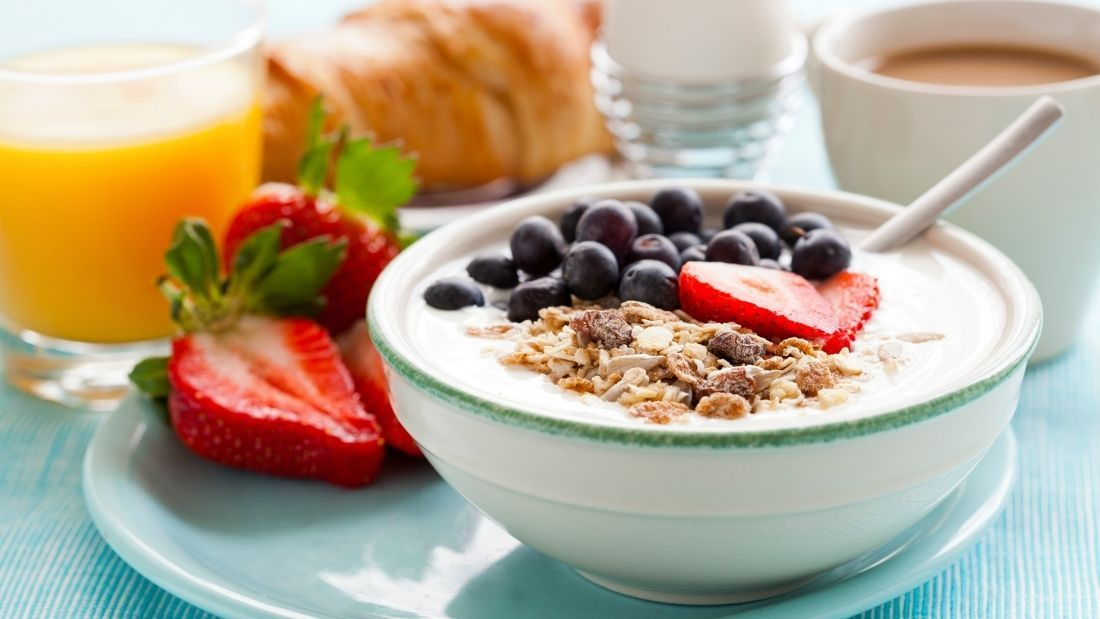 a bowl of oats with fruit